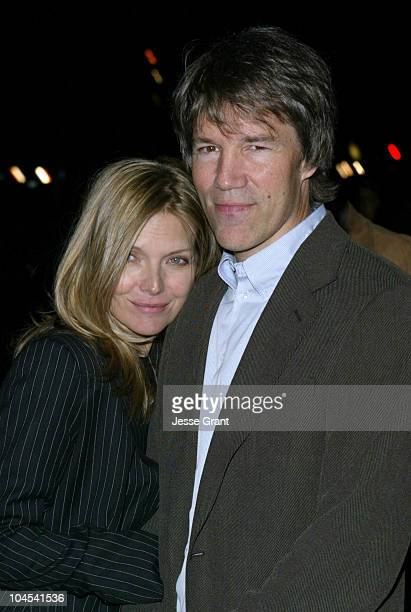 Michelle Pfeiffer and David E Kelley during The CAA PreGolden Globes Party at The Buffalo Club in Santa Monica California United States