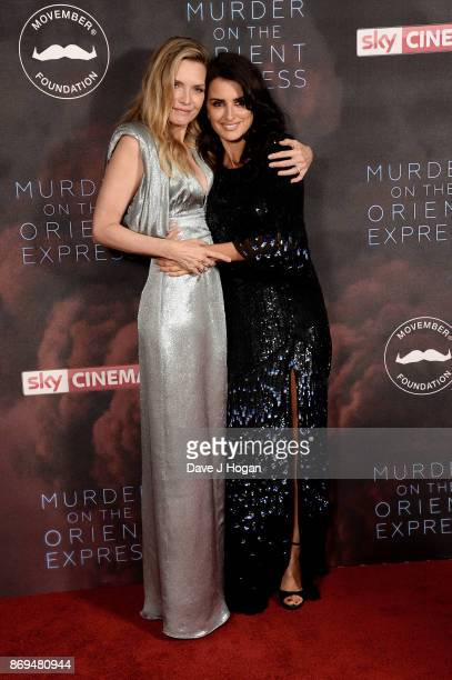 Michelle Pfeiffer and Penelope Cruz attend the 'Murder On The Orient Express' World Premiere at Royal Albert Hall on November 2 2017 in London England