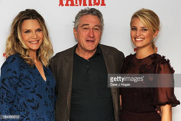 Michelle Pfeiffer Robert De Niro and Dianna Agron attend a photocall for 'The Family' at The Dorchester Hotel on October 14 2013 in London England