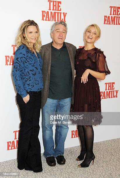 Michelle Pfeiffer Robert De Niro and Dianna Agron attend photocall for 'The Family' at The Dorchester on October 14 2013 in London England