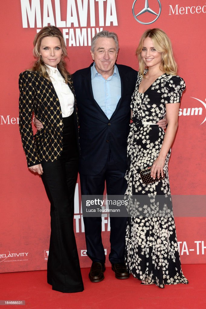 Michelle Pfeiffer Robert De Niro and Dianna Agron attend the 'Malavita The Family' Germany Premiere at Kino in der Kulturbrauerei on October 15 2013...