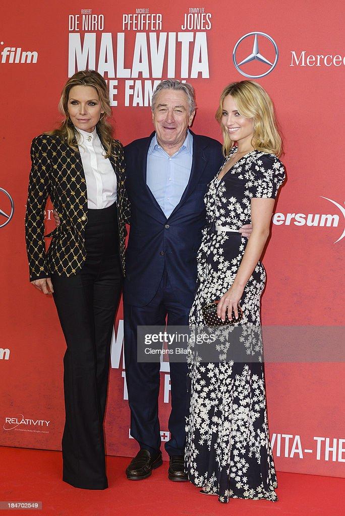 Michelle Pfeiffer, Robert De Niro and Dianna Agron attend the 'Malavita' premiere at Kino in der Kulturbrauerei on October 15, 2013 in Berlin, Germany.