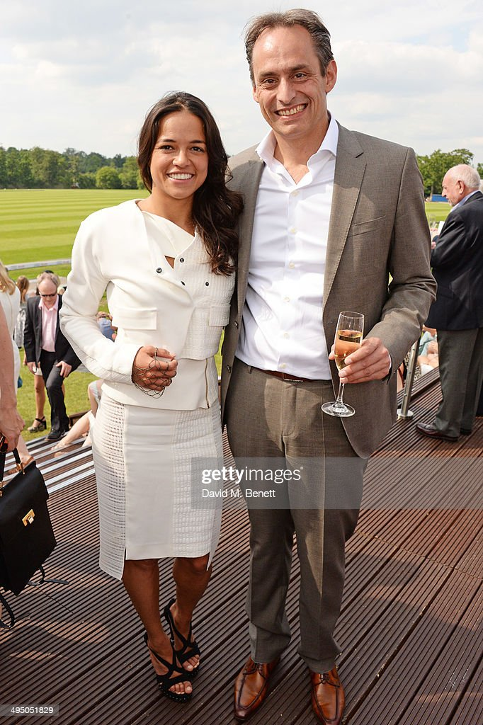 Michelle Rodriguez (L) and Andre Konsbruck, Director of Audi UK, attend day two of the Audi Polo Challenge at Coworth Park Polo Club on June 1, 2014 in Ascot, England.