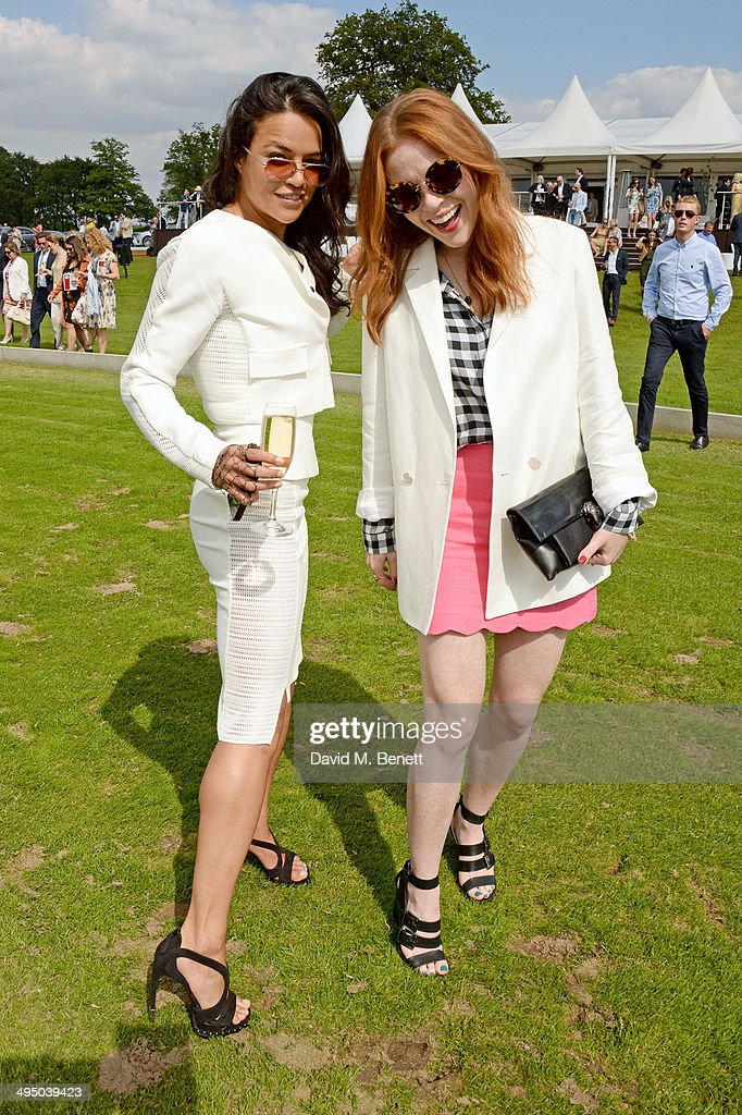 Michelle Rodriguez (L) and Angela Scanlon attend day two of the Audi Polo Challenge at Coworth Park Polo Club on June 1, 2014 in Ascot, England.