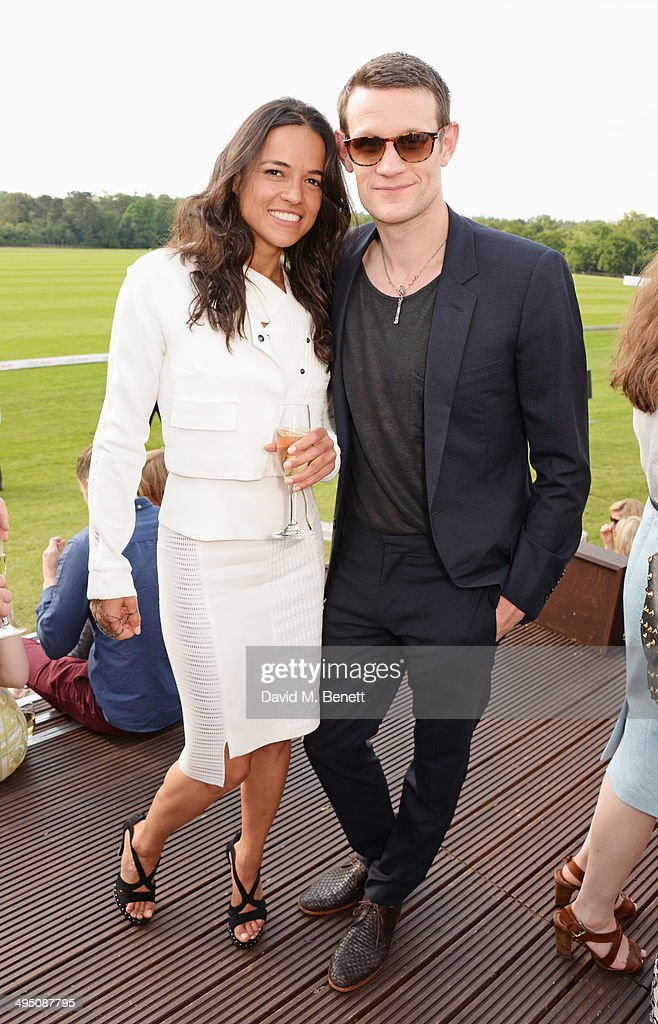 Michelle Rodriguez (L) and Matt Smith attend day two of the Audi Polo Challenge at Coworth Park Polo Club on June 1, 2014 in Ascot, England.