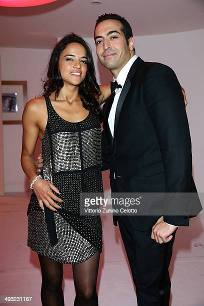 Michelle Rodriguez and Mohammed Al Turki attend the Moncler The After Party To Benefit amfAR at Hotel du CapEdenRoc on May 22 2014 in Cap d'Antibes...