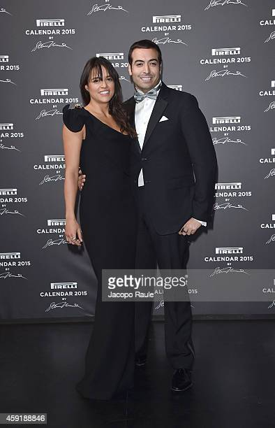 Michelle Rodriguez and Mohammed al Turki attends the 2015 Pirelli Calendar Red Carpet on November 18 2014 in Milan Italy