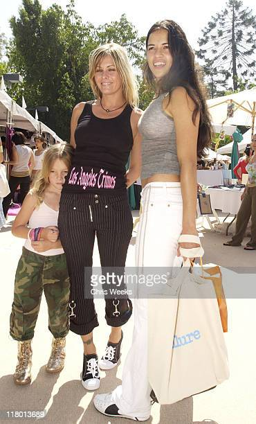 Michelle Rodriguez and Nicole Eggert during The Silver Spoon Beauty Buffet Sponsored By Allure Day Two at Private Residence in Los Angeles California...