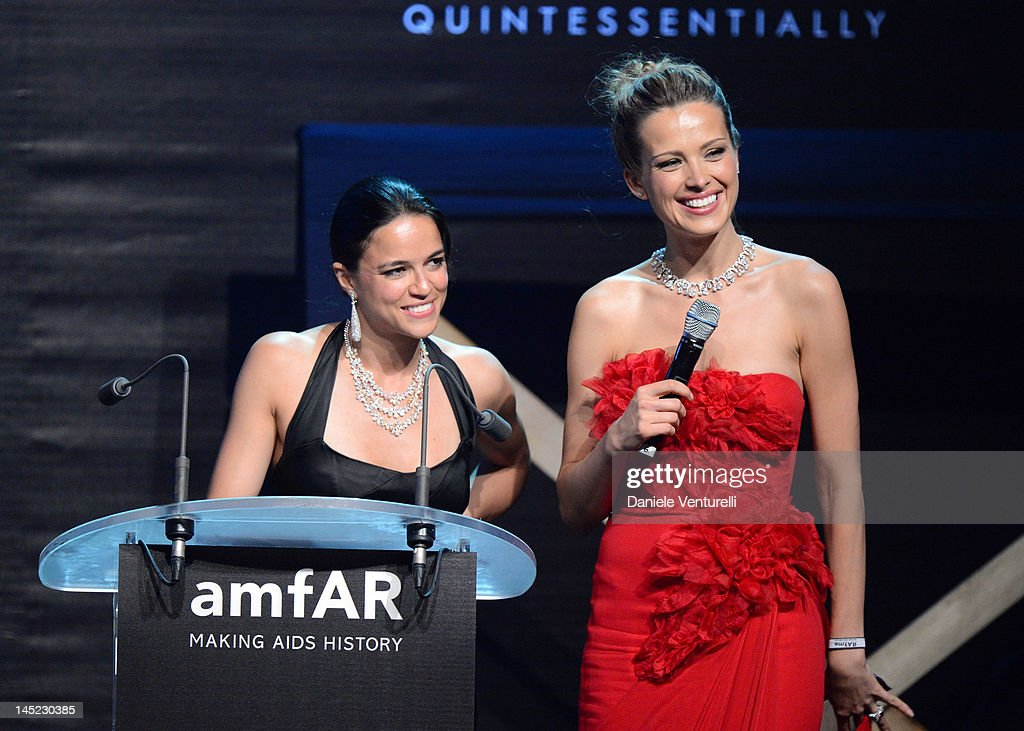 Michelle Rodriguez and Petra Nemcova speak at the 2012 amfAR's Cinema Against AIDS during the 65th Annual Cannes Film Festival at Hotel Du Cap on May 24, 2012 in Cap D'Antibes, France.
