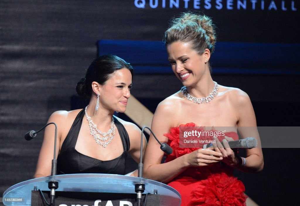 <a gi-track='captionPersonalityLinkClicked' href=/galleries/search?phrase=Michelle+Rodriguez&family=editorial&specificpeople=206182 ng-click='$event.stopPropagation()'>Michelle Rodriguez</a> and <a gi-track='captionPersonalityLinkClicked' href=/galleries/search?phrase=Petra+Nemcova&family=editorial&specificpeople=201716 ng-click='$event.stopPropagation()'>Petra Nemcova</a> speak at the 2012 amfAR's Cinema Against AIDS during the 65th Annual Cannes Film Festival at Hotel Du Cap on May 24, 2012 in Cap D'Antibes, France.