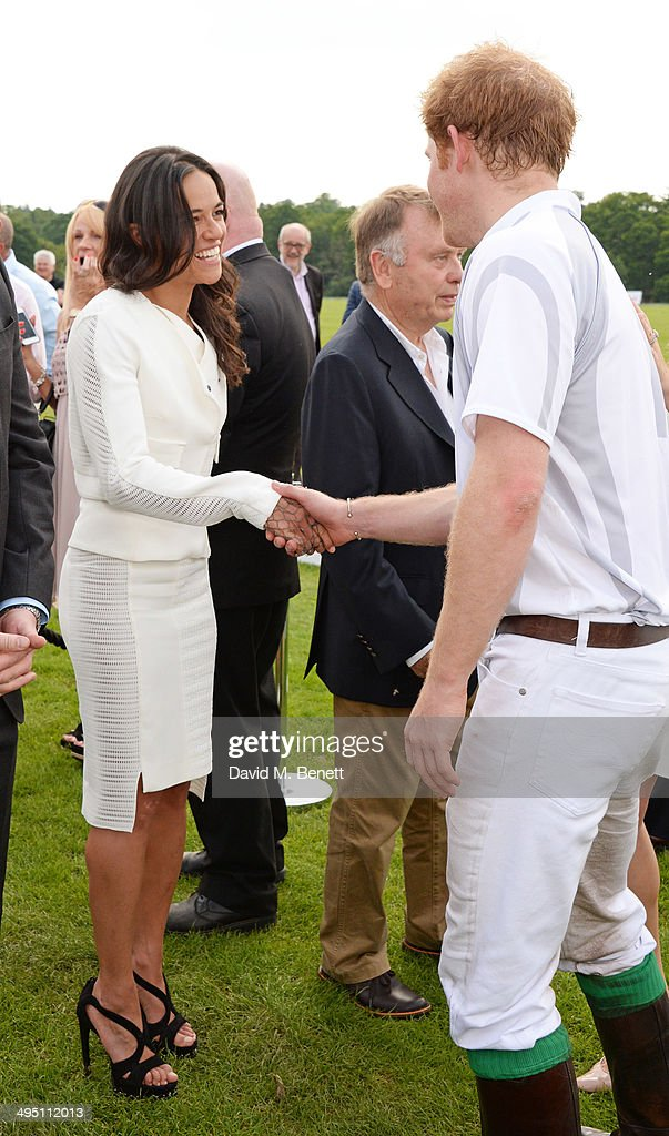 Michelle Rodriguez (L) and Prince Harry attend day two of the Audi Polo Challenge at Coworth Park Polo Club on June 1, 2014 in Ascot, England.