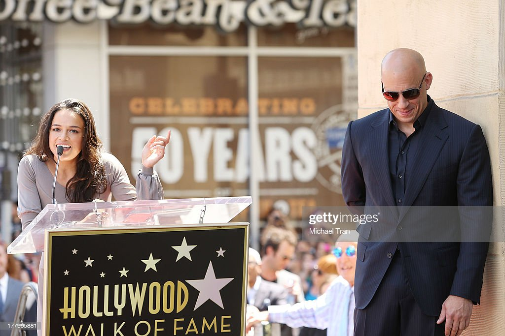<a gi-track='captionPersonalityLinkClicked' href=/galleries/search?phrase=Michelle+Rodriguez&family=editorial&specificpeople=206182 ng-click='$event.stopPropagation()'>Michelle Rodriguez</a> and <a gi-track='captionPersonalityLinkClicked' href=/galleries/search?phrase=Vin+Diesel&family=editorial&specificpeople=171983 ng-click='$event.stopPropagation()'>Vin Diesel</a> attend the ceremony honoring <a gi-track='captionPersonalityLinkClicked' href=/galleries/search?phrase=Vin+Diesel&family=editorial&specificpeople=171983 ng-click='$event.stopPropagation()'>Vin Diesel</a> with a Star on The Hollywood Walk of Fame held on August 26, 2013 in Hollywood, California.