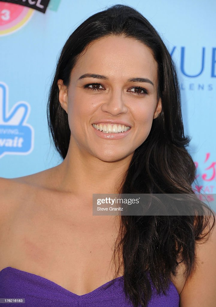 Michelle Rodriguez arrives at the 2013 Teen Choice Awards at Gibson Amphitheatre on August 11, 2013 in Universal City, California.
