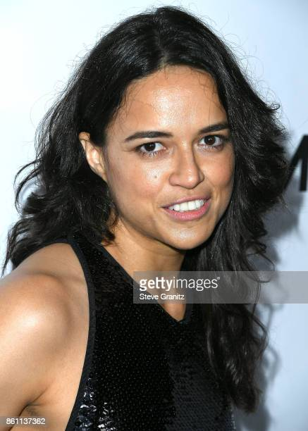 Michelle Rodriguez arrives at the amfAR Los Angeles 2017 at Ron Burkleâs Green Acres Estate on October 13 2017 in Beverly Hills Californi