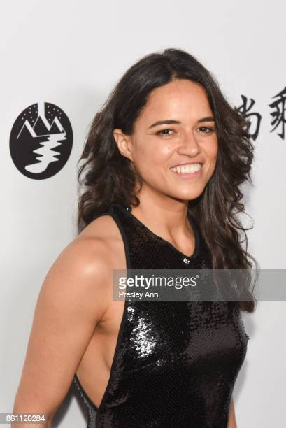 Michelle Rodriguez attends amfAR Los Angeles 2017 Arrivals at Ron Burkleâs Green Acres Estate on October 13 2017 in Beverly Hills Californi
