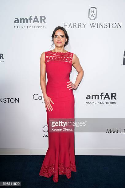Michelle Rodriguez attends the 2016 amfAR Hong Kong gala with a guest at Shaw Studios on March 19 2016 in Hong Kong Hong Kong