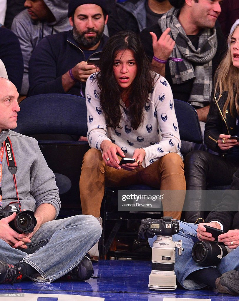 Michelle Rodriguez attends the Detroit Pistons vs New York Knicks game at Madison Square Garden on January 7, 2014 in New York City.