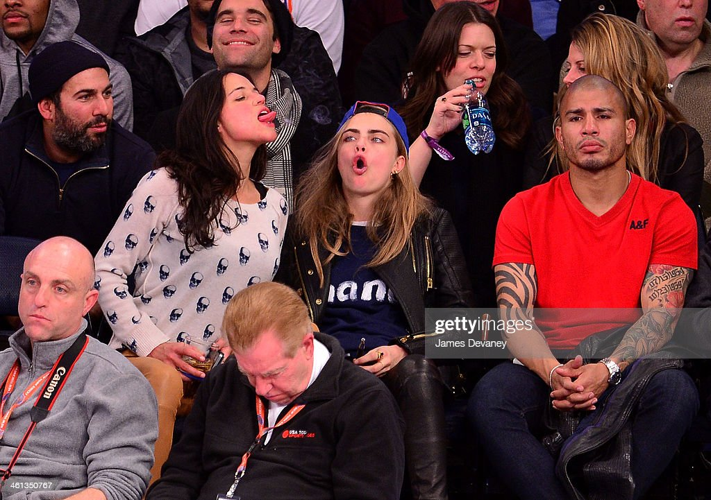Michelle Rodriguez, Cara Delevingne and Miguel Cotto attend the Detroit Pistons vs New York Knicks game at Madison Square Garden on January 7, 2014 in New York City.