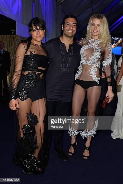 Michelle Rodriguez Mohammed Al Turki and Jessica Stam pose as they attend dinner during The Leonardo DiCaprio Foundation 2nd Annual SaintTropez Gala...
