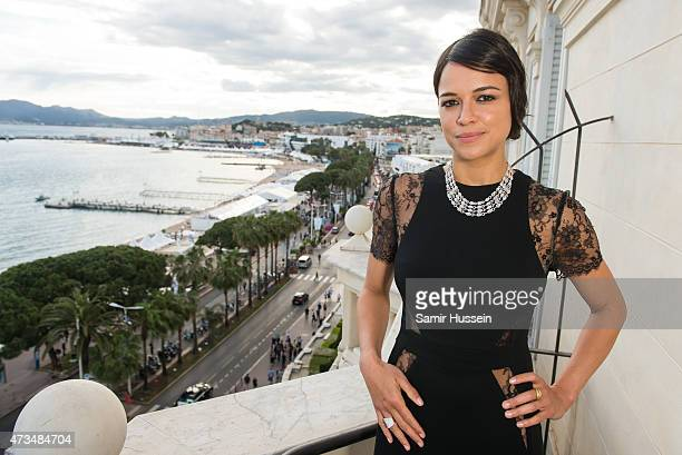 Michelle Rodriguez poses on the balcony of The Avakian Suite during The 68th Annual Cannes Film Festival at The Carlton on May 15 2015 in Cannes...