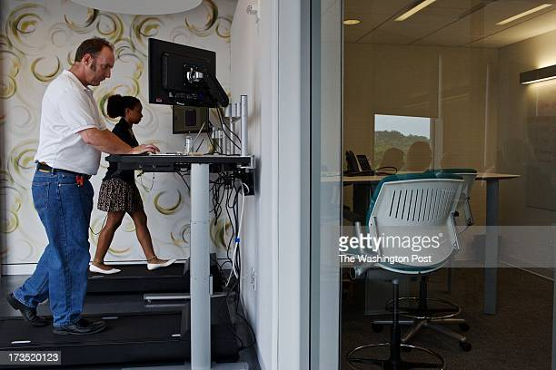 Michelle Schneider and Dave Dunn use the treadmill desks at Evolent a health care startup company in Arlington VA They plan to help create a system...