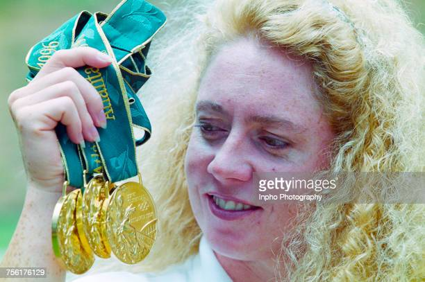 Michelle Smith of Ireland poses with her three gold medals after winning the Women's 400 metres Freestyle Women's 200 metre individual medley and the...