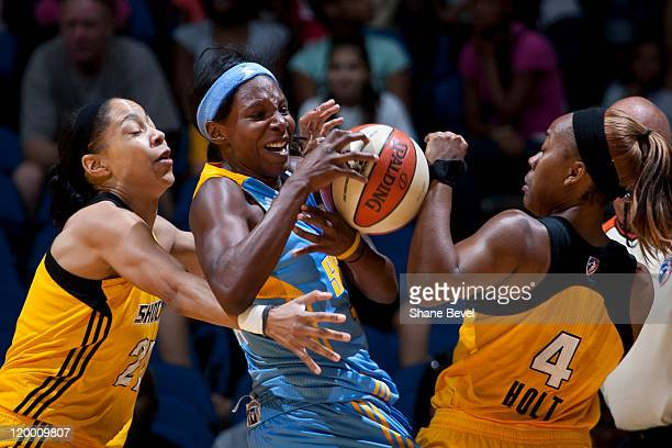 Michelle Snow of the Chicago Sky battles for a loose ball with Jennifer Lacy and Amber Holt of the Tulsa Shock during the WNBA game on July 28 2011...
