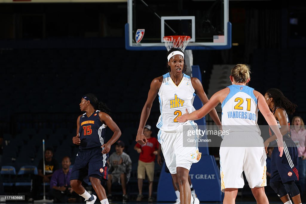 <a gi-track='captionPersonalityLinkClicked' href=/galleries/search?phrase=Michelle+Snow&family=editorial&specificpeople=208195 ng-click='$event.stopPropagation()'>Michelle Snow</a> #2 of the Chicago Sky reacts after hitting a clutch basket in the fourth quarter on her way past teammate <a gi-track='captionPersonalityLinkClicked' href=/galleries/search?phrase=Courtney+Vandersloot&family=editorial&specificpeople=7642430 ng-click='$event.stopPropagation()'>Courtney Vandersloot</a> #21 during the WNBA game against the Connecticut Sun on June 23, 2011 at the All-State Arena in Rosemont, Illinois.