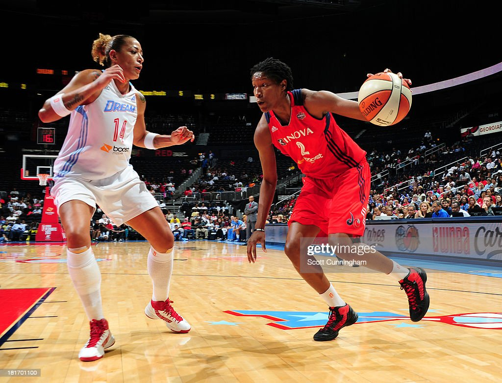 <a gi-track='captionPersonalityLinkClicked' href=/galleries/search?phrase=Michelle+Snow&family=editorial&specificpeople=208195 ng-click='$event.stopPropagation()'>Michelle Snow</a> #2 of the Washington Mystics drives against Erika de Souza #14 of the Atlanta Dream during Game three Eastern Conference Semifinals on September 23, 2013 at Philips Arena in Atlanta, Georgia.