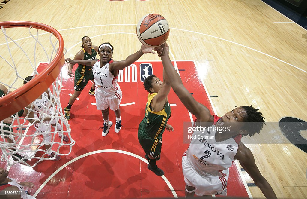 <a gi-track='captionPersonalityLinkClicked' href=/galleries/search?phrase=Michelle+Snow&family=editorial&specificpeople=208195 ng-click='$event.stopPropagation()'>Michelle Snow</a> #2 of the Washington Mystics reaches for a rebound against the Seattle Storm at the Verizon Center on July 6, 2012 in Washington, DC.