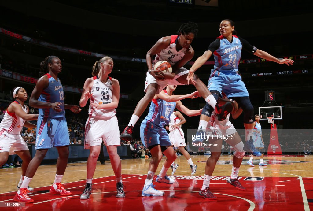 <a gi-track='captionPersonalityLinkClicked' href=/galleries/search?phrase=Michelle+Snow&family=editorial&specificpeople=208195 ng-click='$event.stopPropagation()'>Michelle Snow</a> #2 of the Washington Mystics rebounds against Armintie Herrington #22 of the Atlanta Dream at the Verizon Center on September 21, 2013 in Washington, DC.
