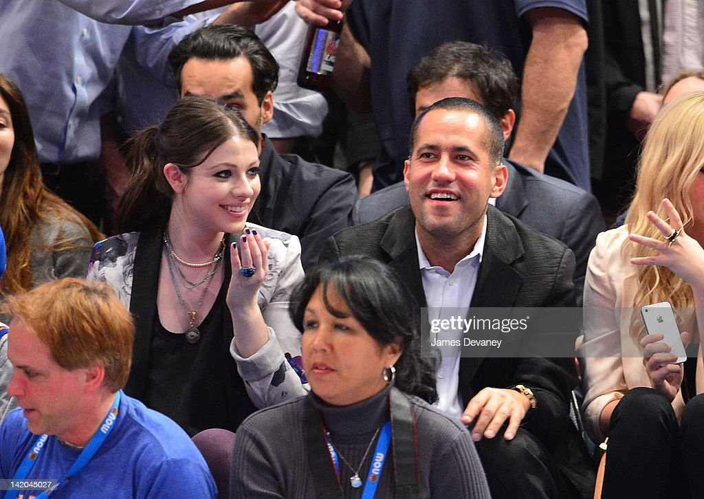 <a gi-track='captionPersonalityLinkClicked' href=/galleries/search?phrase=Michelle+Trachtenberg&family=editorial&specificpeople=202081 ng-click='$event.stopPropagation()'>Michelle Trachtenberg</a> and guest attend the Orlando Magic vs New York Knicks game at Madison Square Garden on March 28, 2012 in New York City.