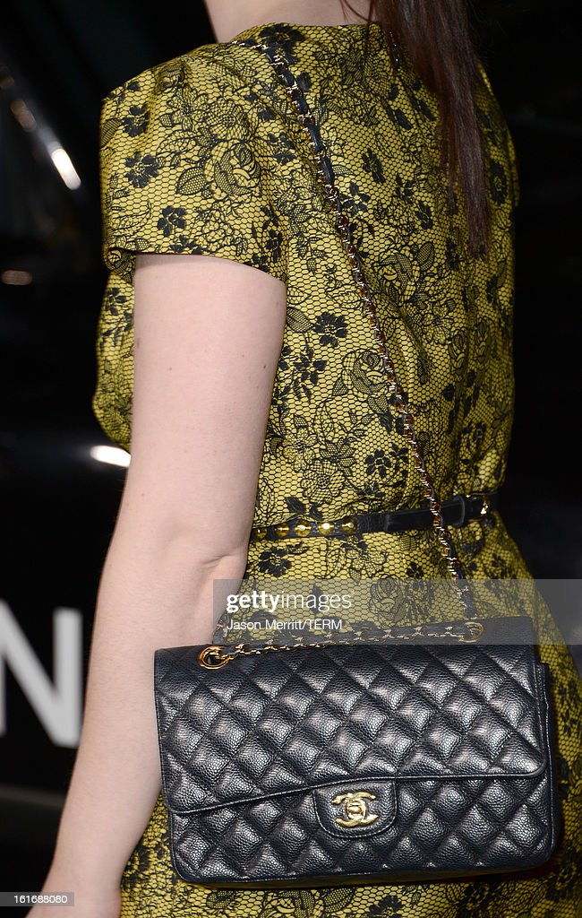 Michelle Trachtenberg arrives at the Topshop Topman LA Opening Party at Cecconi's West Hollywood on February 13, 2013 in Los Angeles, California.