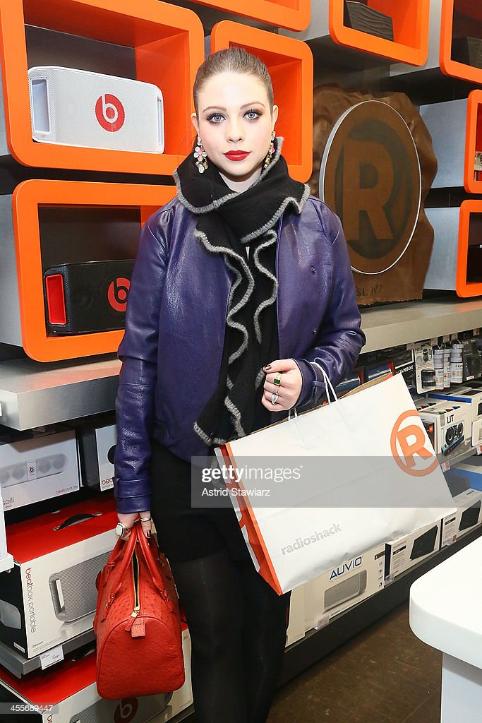 <a gi-track='captionPersonalityLinkClicked' href=/galleries/search?phrase=Michelle+Trachtenberg&family=editorial&specificpeople=202081 ng-click='$event.stopPropagation()'>Michelle Trachtenberg</a> attends the Charlotte Ronson Holiday Party at RadioShack Pop-Up Store in Times Square on December 12, 2013 in New York City.