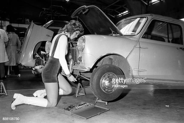 Michelle Tucker does her own maintenance work on her Mini at 'Moonlight Bay' a DIY car repair centre The customer can buy time in the bays and use...