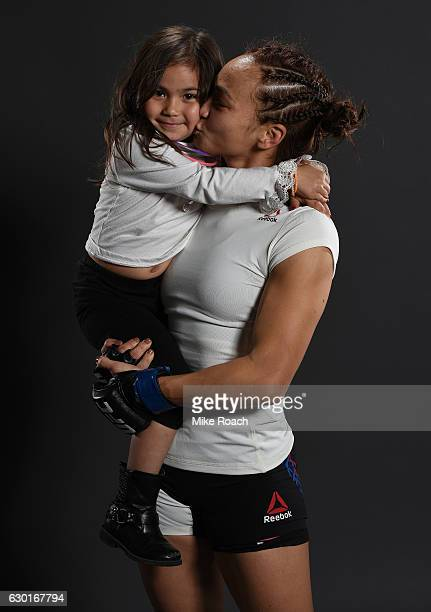 Michelle Waterson and daughter Araya pose for a portrait backstage after her victory over Paige VanZant during the UFC Fight Night event inside the...