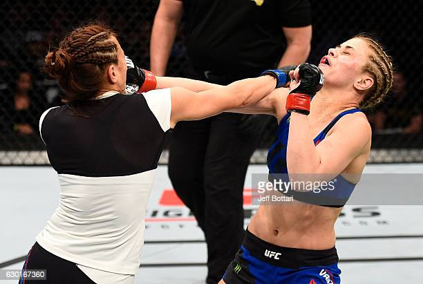 Michelle Waterson and Paige VanZant trade punches in their women's strawweight bout during the UFC Fight Night event inside the Golden 1 Center Arena...