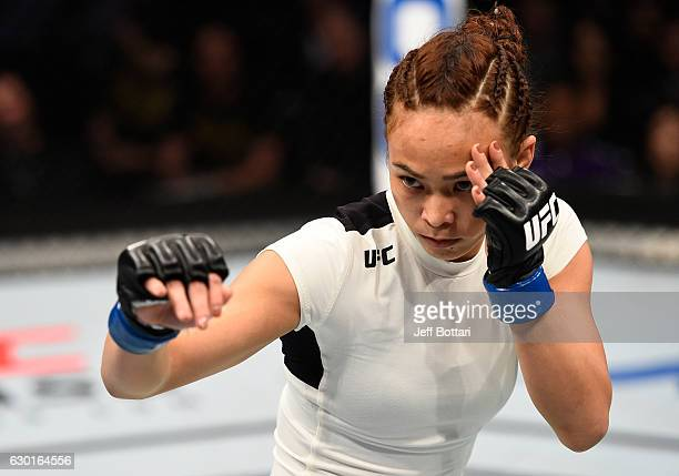 Michelle Waterson battles Paige VanZant in their women's strawweight bout during the UFC Fight Night event inside the Golden 1 Center Arena on...