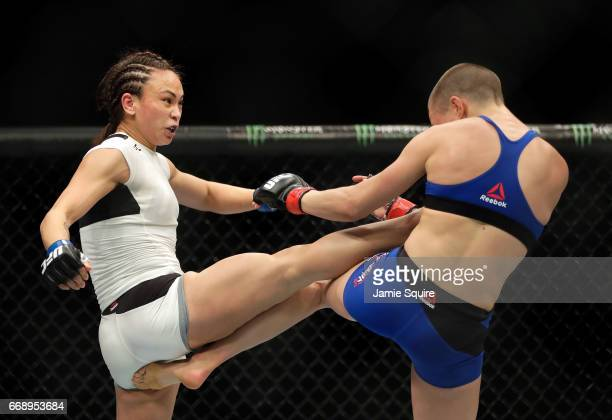 Michelle Waterson battles Rose Namajunas during their Women's Strawweight bout on UFC Fight Night at the Sprint Center on April 15 2017 in Kansas...