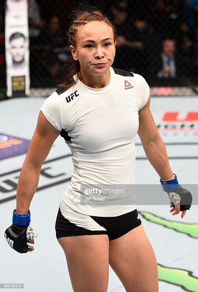 Michelle Waterson celebrates after her submission victory over Paige VanZant in their women's strawweight bout during the UFC Fight Night event inside the Golden 1 Center Arena on December 17, 2016 in Sacramento, California.