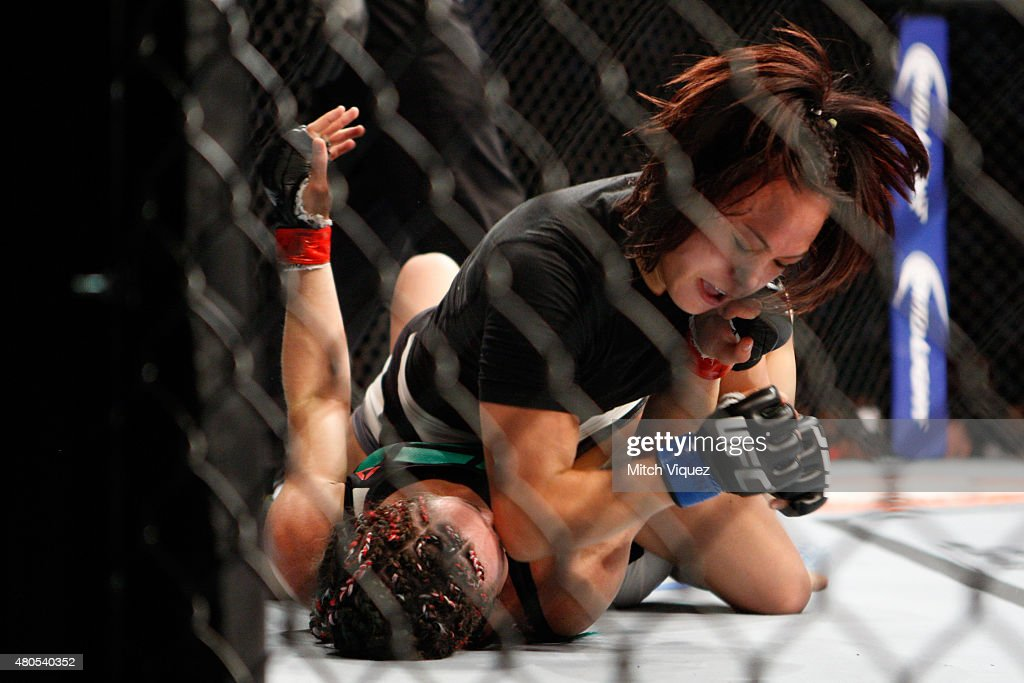 Michelle Waterson (top) elbows Angela Magana in their women's strawweight bout during the Ultimate Fighter Finale inside MGM Grand Garden Arena on July 12, 2015 in Las Vegas, Nevada.