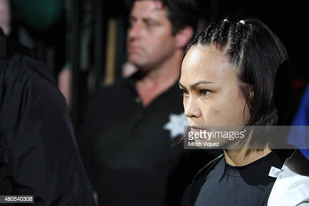 Michelle Waterson enters the arena for her fight against Angela Magana in their women's strawweight bout during the Ultimate Fighter Finale inside...