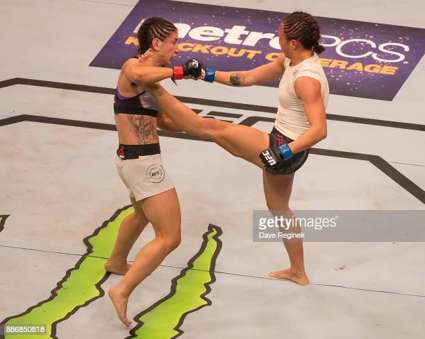 Michelle Waterson fights Tecia Torres during a UFC bout at Little Caesars Arena on December 2 2017 in Detroit Michigan Torres defeated Waterson by...