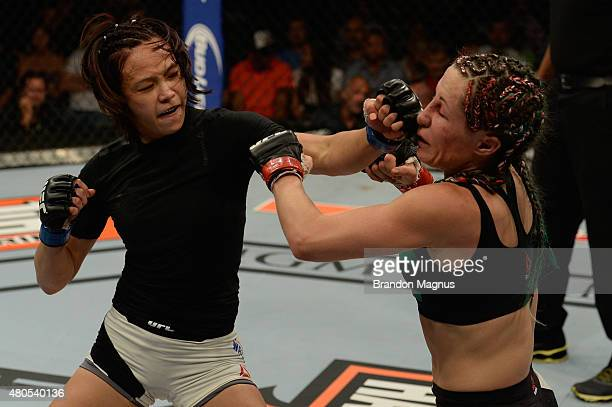 Michelle Waterson punches Angela Magana in their women's strawweight bout during the Ultimate Fighter Finale inside MGM Grand Garden Arena on July 12...