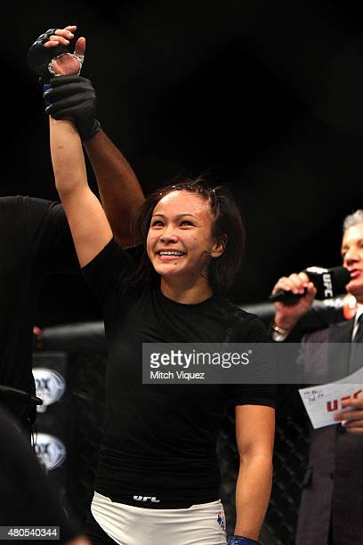 Michelle Waterson reacts to her victory over Angela Magana in their women's strawweight bout during the Ultimate Fighter Finale inside MGM Grand...