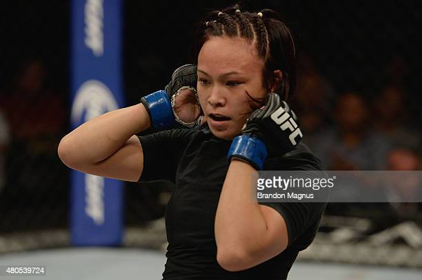 Michelle Waterson walks back to her corner in her women's strawweight bout during the Ultimate Fighter Finale inside MGM Grand Garden Arena on July...