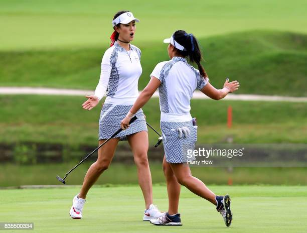 Michelle Wie and Danielle Kang of Team USA celebrate a birdie to win the third hole over Team Europe during the morning foursomes matches of the...