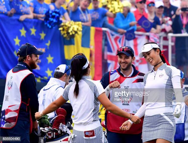 Michelle Wie and Danielle Kang of Team USA dance on the first tee during the morning foursomes matches of the Solheim Cup at the Des Moines Golf and...