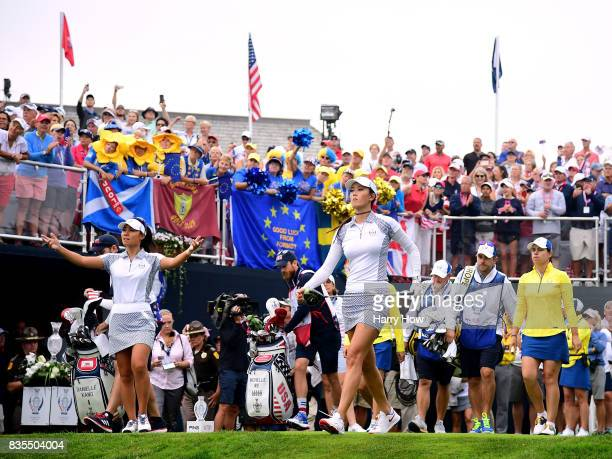 Michelle Wie and Danielle Kang of Team USA react to their tee shot on the first hole during the morning foursomes matches of the Solheim Cup at the...