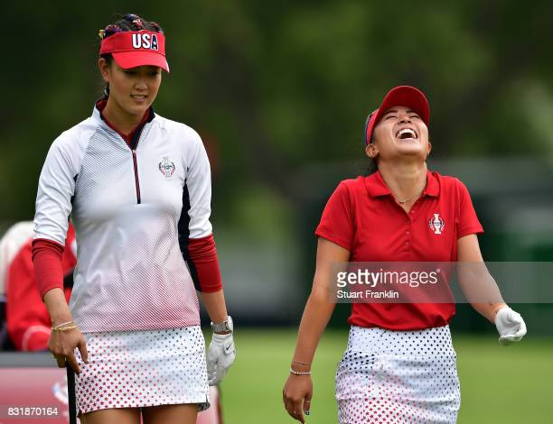 Michelle Wie and Danielle Kang of Team USA share a joke during practice for The Solheim Cup at the Des Moines Country Club on August 15 2017 in West...
